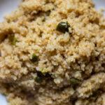 Close up of quinoa with flecks of jalapeño pepper.