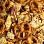 Close up of Chex mix with nuts and pretzels