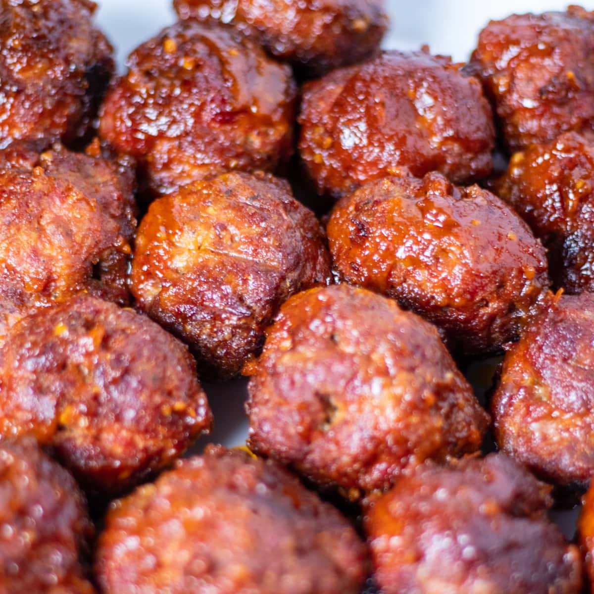 Close up of meatballs cooked in BBQ sauce