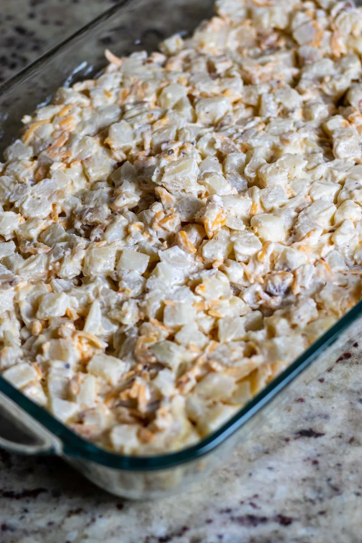 Potato mixture in casserole dish.