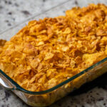 close up of hashbrown casserole in a glass baking dish