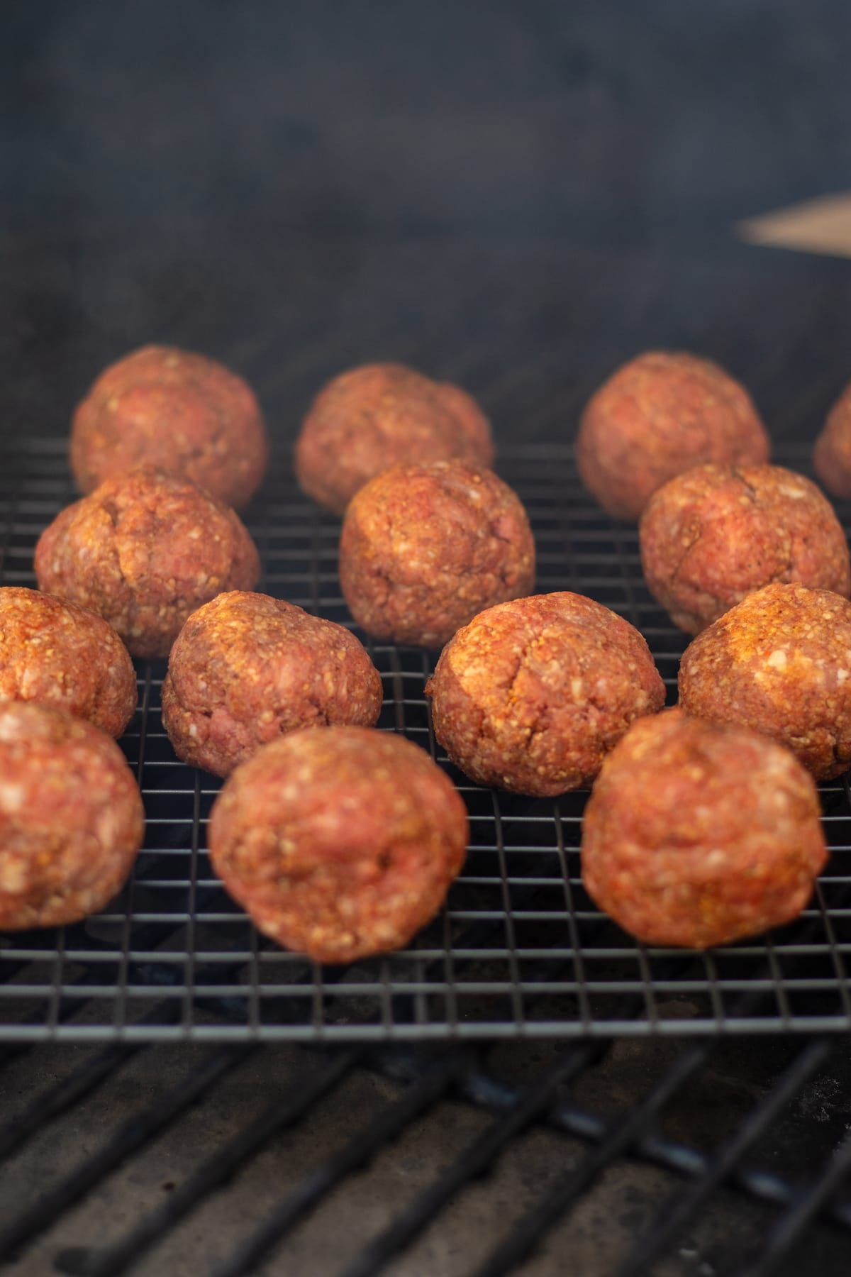 raw meatballs on the smoker