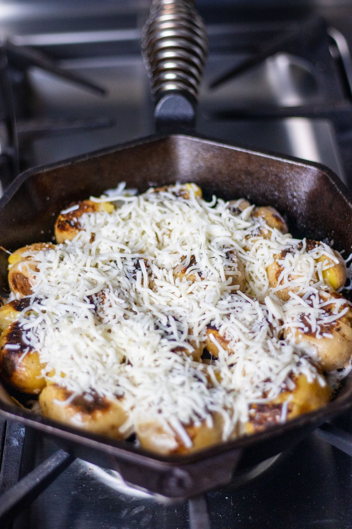 Cheese on potatoes in a skillet