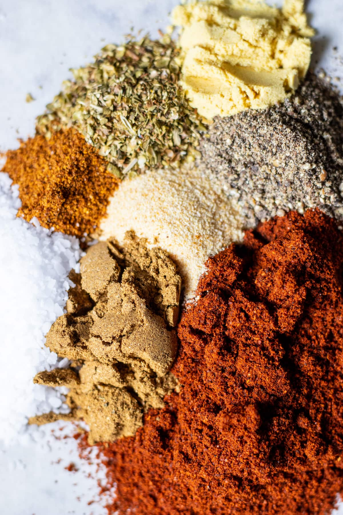 spices for the rub on a piece of parchment paper