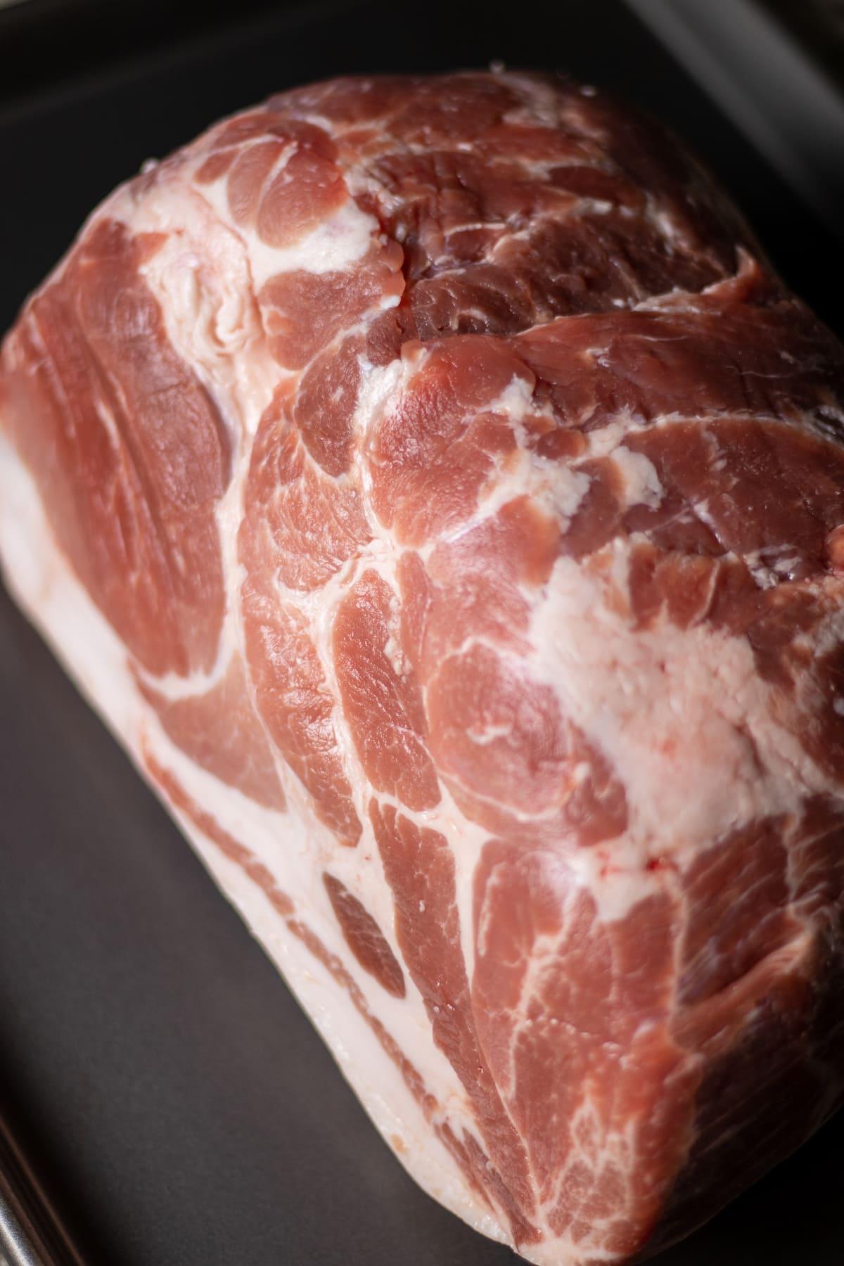 a raw pork butt.