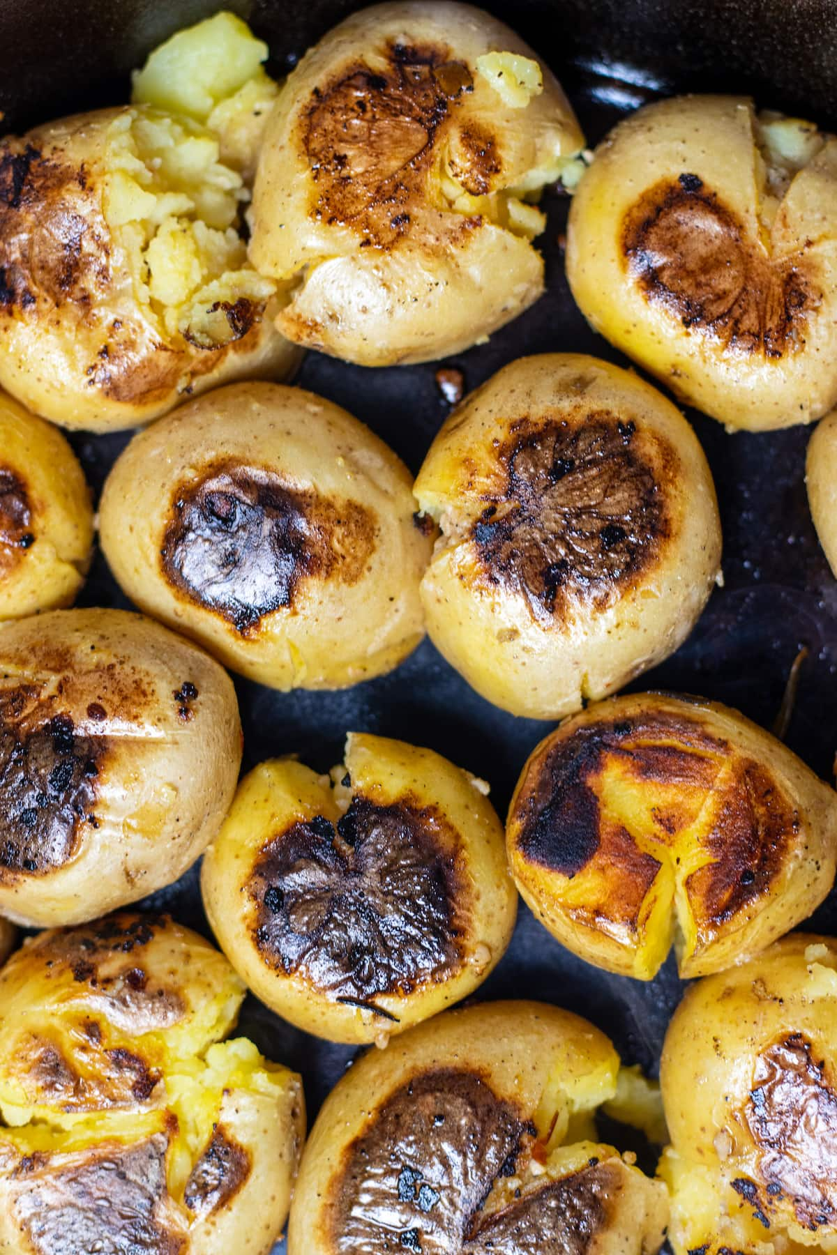 crisped skin on potatoes in a skillet.